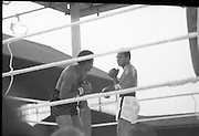 Ali vs Lewis Fight, Croke Park,Dublin..1972..19.07.1972..07.19.1972..19th July 1972..As part of his built up for a World Championship attempt against the current champion, 'Smokin' Joe Frazier,Muhammad Ali fought Al 'Blue' Lewis at Croke Park,Dublin,Ireland. Muhammad Ali won the fight with a TKO when the fight was stopped in the eleventh round....Image of a snarling Ali as he prepares to throw a right to the head of Lewis.