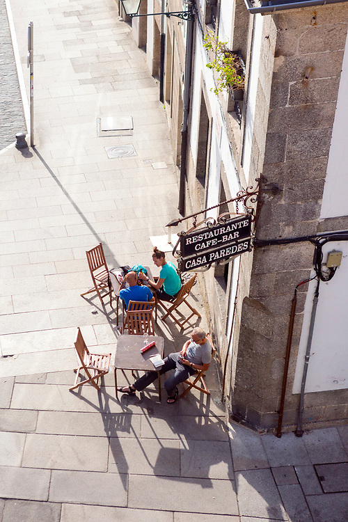 SANTIAGO DE COMPOSTELA, SPAIN - 14th of October - Tourists enjoy sampling local cuisine at a tapas bar in Santiago de Compostela, Galicia, Spain.