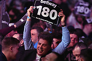 Fans celebrate a maximum during the Betway Premier League Darts at the Manchester Arena, Manchester, United Kingdom on 23 March 2017. Photo by Mark Pollitt.