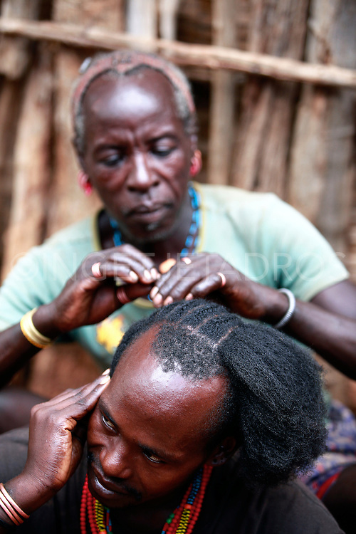 To protect their prized hairdos, Hamar men at all times carry with them a borkoto or carved stool which they use as a headrest. Exclusive at AuroraPhotos.<br /> http://www.auroraphotos.com/SwishSearch?Keywords=Ingetje+Tadros&amp;submit=Go!