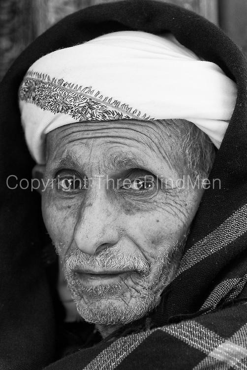 Yemen. <br />Portrait of gentleman in the Souk.<br />2007