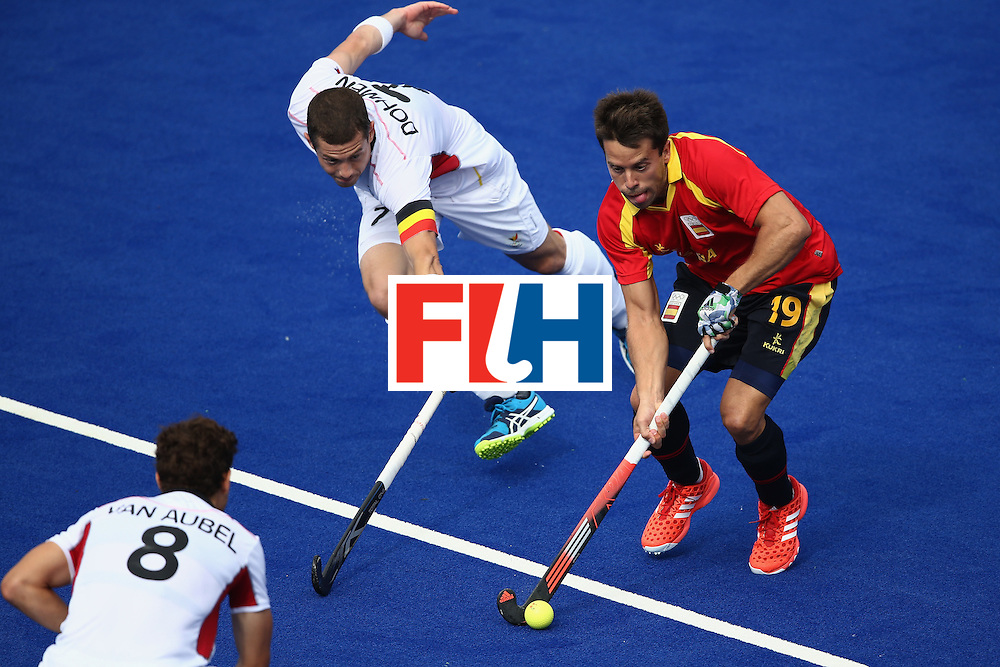 RIO DE JANEIRO, BRAZIL - AUGUST 11:  John-John Dohmen #7 of Belgium defends against Marc Salles #19 of Spain during a Men's Preliminary Pool A match on Day 6 of the Rio 2016 Olympics at the Olympic Hockey Centre on August 11, 2016 in Rio de Janeiro, Brazil.  (Photo by Sean M. Haffey/Getty Images)