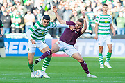Tom Rogic (#18) of Celtic FC holds off Olly Lee (#8) of Heart of Midlothian during the Betfred League Cup semi-final match between Heart of Midlothian FC and Celtic FC at the BT Murrayfield Stadium, Edinburgh, Scotland on 28 October 2018.