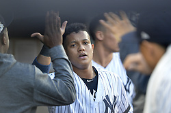 October 18, 2017 - Bronx, NY, USA - The New York Yankees' Starlin Castro, middle, scores on an RBI single by Greg Bird in the second inning against the Houston Astros in Game 5 of the American League Championship Series at Yankee Stadium in New York on Wednesday, Oct. 18, 2017. (Credit Image: © Howard Simmons/TNS via ZUMA Wire)