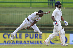 August 12, 2017 - Colombo, Sri Lanka - Sri Lankan cricketer Vishwa Fernando(L) delivers a ball as India's Shikhar Dhawan.. looks on during the 1st Day's play in the 3rd Test match between Sri Lanka and India at the Pallekele International cricket stadium, Kandy, Sri Lanka on Saturday 12 August 2017. (Credit Image: © Tharaka Basnayaka/NurPhoto via ZUMA Press)