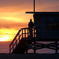 Antonio Rincon, 21, watches the sun as it sets at Santa Monica Beach on Sunday, December 27, 2009.