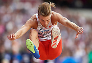Great Britain, London - 2017 August 04: Piotr Jaszczuk (WLKS Iganie Nowe) competes in men's long jump qualification during IAAF World Championships London 2017 at  London Stadium on August 04, 2017 in London, Great Britain.<br /> <br /> Mandatory credit:<br /> Photo by © Adam Nurkiewicz<br /> <br /> Adam Nurkiewicz declares that he has no rights to the image of people at the photographs of his authorship.<br /> <br /> Picture also available in RAW (NEF) or TIFF format on special request.<br /> <br /> Any editorial, commercial or promotional use requires written permission from the author of image.