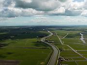 Nederland, Noord-Holland, Beemster, 16-04-2012;  De Beemster, 400 jaar 1612 - 2012. Het Noordhollandsch kanaal (tevens Beemsterrringvaart). Rechts van het kanaal de Polder Wormer, Jisp en Nek - de onregelmatige vormen van deze polder contrasteren met de beroemde geometrische verkaveling van de 17e eeuwse droogmakerij. De Beemster is wereld erfgoed (Unesco werelderfgoedlijst)..The famous geometrical well-ordered polder Beemster, 17th century  reclaimed landscape, Unesco world heritage..luchtfoto (toeslag), aerial photo (additional fee required);.copyright foto/photo Siebe Swart