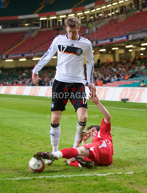 CARDIFF, WALES - Wednesday, April 1, 2009: Wales' Gareth Bale and Germany's Per Mertesacker during the 2010 FIFA World Cup Qualifying Group 4 match at the Millennium Stadium. (Pic by David Rawcliffe/Propaganda)