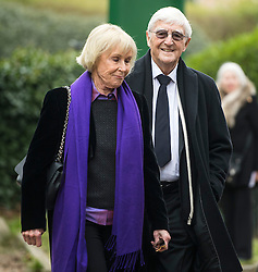 © Licensed to London News Pictures. 18/04/2016. Shirley, UK.  Michael Parkinson and wife Mary Parkinson arrive for the funeral of comedian, actor, writer Ronnie Corbett, held at St John the Evangelist Church in Shirley near Croydon. Corbett, who was most famous for his comedy sketch show  The Two Ronnies, performed with the late Ronnie Barker, died at the age of 85. Photo credit: Ben Cawthra/LNP
