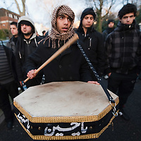 LONDON, ENGLAND - DECEMBER 27:  A Shia Muslim worshipper beats a drum at the Ashura procession from Marble Arch to Holland Park Mosque on December 27, 2009 in London, England. Ashura is a 10 day period of mourning for Imam Hussein, the seven-century grandson of Prophet Mohammad who was killed in a battle in Karbala in Iraq, in 680 AD.  (Photo by Marco Secchi/Getty Images)