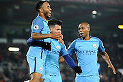 Raheem Sterling (7) of Manchester City, Sergio Aguero (10) of Manchester City and Fernandinho (25) of Manchester City celebrate the scoring of the second goal for a 2-0 leadduring the Premier League match between Bournemouth and Manchester City at the Vitality Stadium, Bournemouth, England on 13 February 2017. Photo by Graham Hunt.