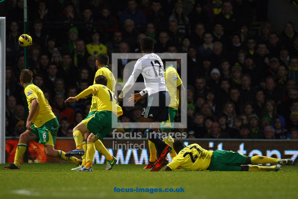 Picture by Paul Chesterton/Focus Images Ltd +44 7904 640267.26/12/2012.John Obi Mikel of Chelsea has a shot on goal during the Barclays Premier League match at Carrow Road, Norwich.