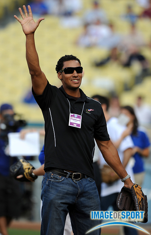 Jul 12, 2008; Los Angeles, CA, USA; U.S. Olympic cyclist Gideon Massie throws out the first pitch before game between the Florida Marlins and Los Angeles Dodgers at Dodger Stadium.