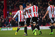 Brentford players celebrate Brentford defender Harlee Dean (6) goal during the EFL Sky Bet Championship match between Brentford and Brighton and Hove Albion at Griffin Park, London, England on 5 February 2017. Photo by Jon Bromley.