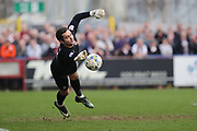 AFC Wimbledon goalkeeper James Shea (1) saves a free-kick from Northampton Town  during the EFL Sky Bet League 1 match between AFC Wimbledon and Northampton Town at the Cherry Red Records Stadium, Kingston, England on 11 March 2017. Photo by Stuart Butcher.
