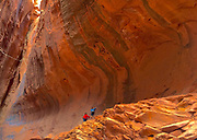 Southwestern Utah, Children climb at Escalante National Monument (Park) Wall