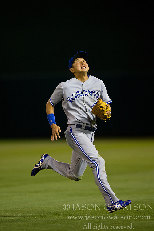 OAKLAND, CA - JULY 05:  Munenori Kawasaki #66 of the Toronto Blue Jays chases a foul ball against the Oakland Athletics during the seventh inning at O.co Coliseum on July 5, 2014 in Oakland, California. The Oakland Athletics defeated the Toronto Blue Jays 5-1.  (Photo by Jason O. Watson/Getty Images) *** Local Caption *** Munenori Kawasaki