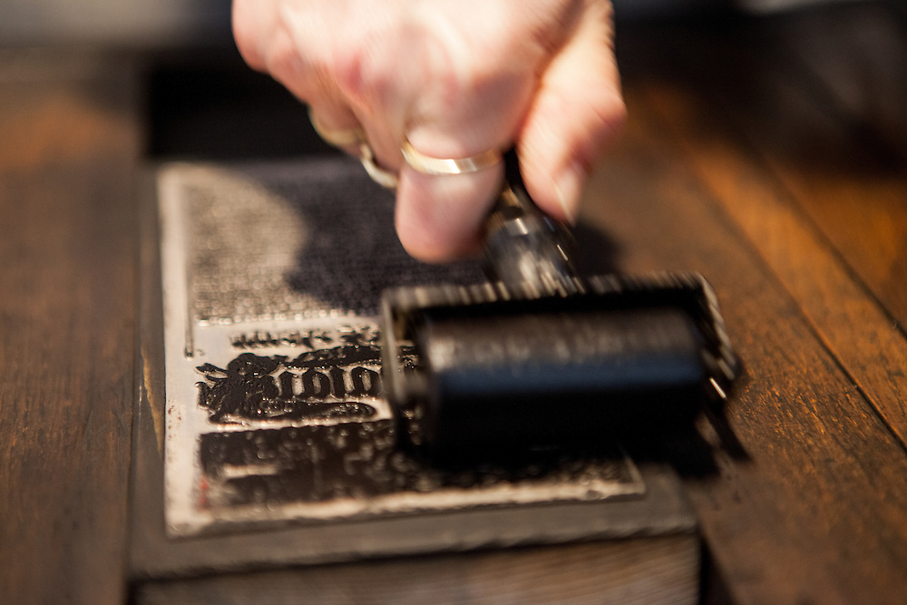 Monika Dolezalova working for the museum in Kralice is demonstrating the old printing technique which was used to print the bible of Kralice which was the first complete translation of the Bible from the original languages into the Czech language. Translated by the Unity of the Brethren and printed in the town of Kralice nad Oslavou, the first edition had six volumes and was published between the years 1579 and 1593.