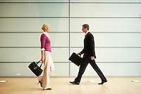 Businesspeople Walking  in Office Hallway side view