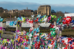 © Licensed to London News Pictures. 22/11/2015. Shoreham By Sea, UK. Hundreds of coloured ribbons fly in the wind on the Tollbridge as a remembrance service is being held in Lancing College chapel for the families of the victims of the Shoreham Airshow Plane crash. Photo credit : Hugo Michiels/LNP