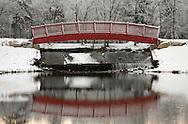 Middletown, New York - A bridge is reflected in a stream after a snowstorm at the National Shrine of Our Lady of Mount Carmel on Dec. 6, 2009.