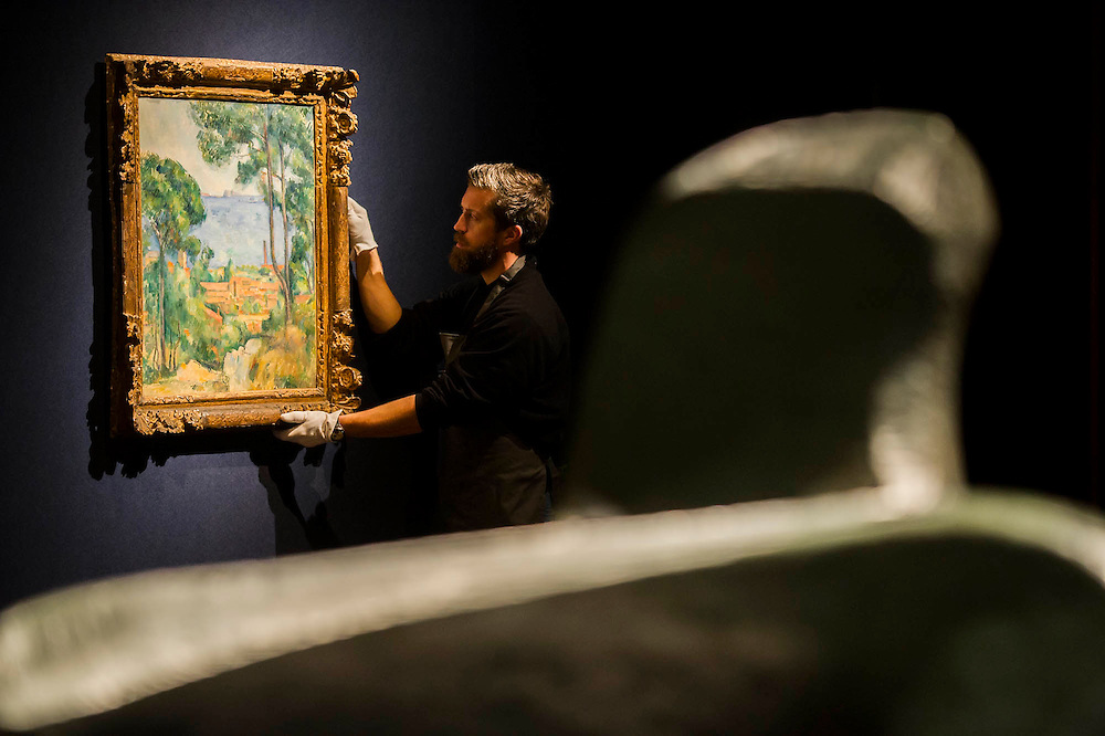 Cézanne's Vue sur L'Estaque et Le Château behind a Henry Moore - Christie's Impressionist, Modern and Surrealist Art pre-sale exhibition ahead of the Evening sale on 4 February. Highlights include: Cézanne's Vue sur L'Estaque et Le Château d'If, from the collection of Samuel Courtauld, which is coming to the market for the first time since it was acquired 79 years ago, in 1936 (estimate: £8-12 million); The most valuable group of Surrealist art ever to be offered at auction, featuring a group of works by Magritte and Miró, led by Joan Miró's L'oiseau au plumage déployé vole vers l'arbre argenté, 1953, from a Distinguished European Collection (estimate: £7-9 million); Amedeo Modigliani's rare double portrait Les deux filles, 1918 (estimate: £6-8 million); Femme de Venise V by Alberto Giacometti (estimate: £6-8 million); Juan Gris's La Lampe, 1914, which is considered to be among the artist's greatest contributions to Cubism (estimate: £2.5-3.5 million); Paysage à L'Estaque, 1907, by Georges Braque (estimate: £2-3 million); An important group of German works from the collection of industrial chemist Carl Hagemann, representing three of the four founding artists of the Die Brücke movement, led by one of the masterpieces of Die Brücke art: Badende am Waldteich by Erich Heckel, along with key works by Ernst Ludwig Kirchner and Karl Schmidt-Rottluff; and other important works by Chagall, Moore, Picabia, Arp, Ernst, Tanguy and Dominguez. The auction has a total pre-sale estimate of £92.8 million-£133.8 million. Christie's, King Street, London, UK.