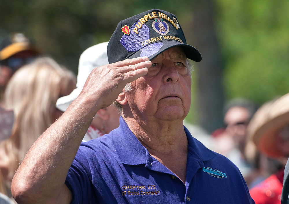 em052917g/a/David Roybal, from Santa Fe and a Purple Heart recipient from serving with the Army in Vietnam, salutes during the Memorial Day ceremony at the Santa Fe National Cemetery on Memorial Day, Monday May 29, 2017. The keynote speaker at the event was Alan Martinez, deputy secretary of the N.M. Dept. of Veterans Services. (Eddie Moore/Albuquerque Journal