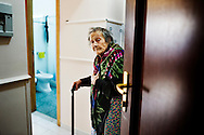 Napoli, Italia - 11 dicembre 2010. La signora Concetta Cerchione, 91,  all'interno della sua stanza/casa nell'albergo Vergilius di Napoli..Ph. Roberto Salomone Ag. Controluce.ITALY - Concetta Cerchione in her room/house in Vergiulius hotel in Naples on December 11, 2010.
