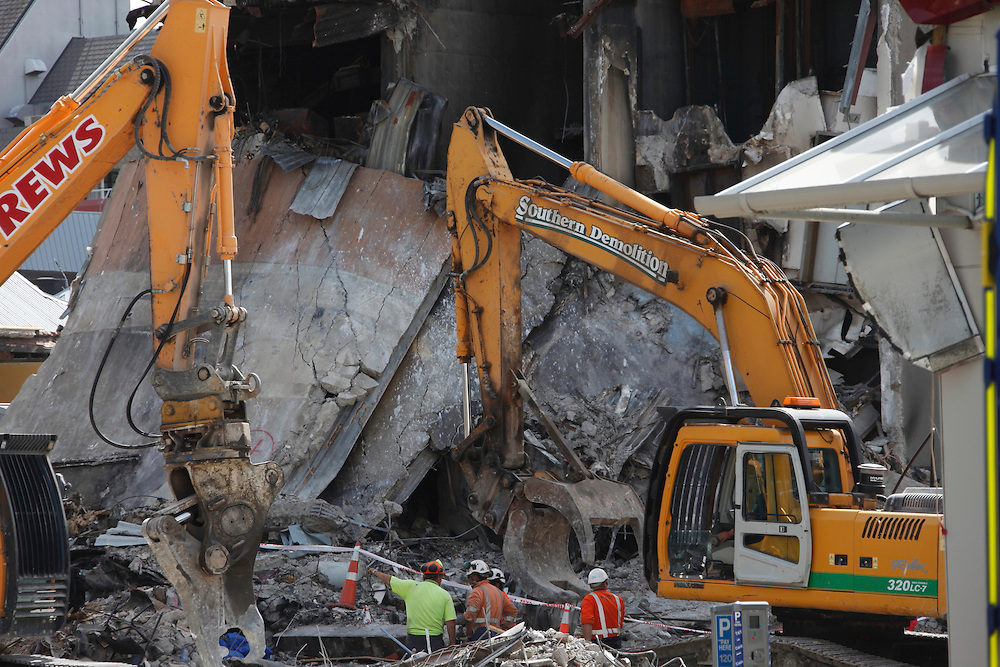 Clean up work at the collapsed Canterbury TV building in the town center of Christchurch, New Zealand