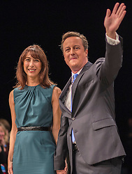 David Cameron Keynote Speech.<br /> Prime Minister David Cameron is joined on stage by his wife Samantha, following his keynote speech to the Conservative Party Conference, Manchester, United Kingdom. Wednesday, 2nd October 2013. Picture by i-Images
