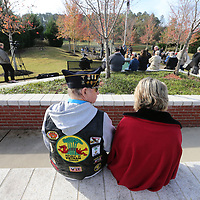 Leon Hulsey, left, of Saltillo looks to his wife, Marylon, as this year's Veterans Day ceremony gets ubderway at Veterans Park in Tupelo Saturday morning.