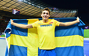 Mondo Duplantis aka Armand Duplantis (SWE) poses with flag after winning the pole vault in a World U20 and  Swedish national record 19-10 1/4 (6.05m) in the European Championships in Berlin, Germany, Sunday, Aug 12, 2018. (Jiro Mochizuki/Image of Sport)