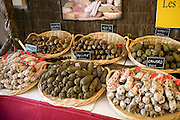 Duck pepper boar herb walnut and hazelnut sausages on sale in Brantome, Dordogne, France