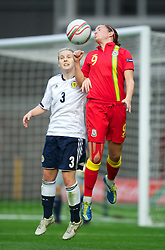 LLANELLI, WALES - Saturday, September 15, 2012: Wales' Helen Lander in action against Scotland's Rachael Small during the UEFA Women's Euro 2013 Qualifying Group 4 match at Parc y Scarlets. (Pic by David Rawcliffe/Propaganda)
