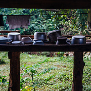 "A local forest ranger prepares lunch in the jungle near Chiang Dao, Thailand. The open air ""cabinets"" of the local people."