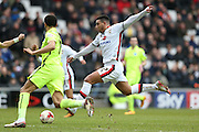 Milton Keynes Dons midfielder Daniel Powell (17) shoots during the Sky Bet Championship match between Milton Keynes Dons and Brighton and Hove Albion at stadium:mk, Milton Keynes, England on 19 March 2016.
