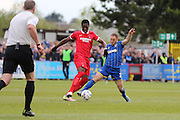 Barry Fuller (Captain) defender for AFC Wimbledon (2) and Armand Gnanduillet striker for Leyton Orient (32)  tussle during the Sky Bet League 2 match between AFC Wimbledon and Leyton Orient at the Cherry Red Records Stadium, Kingston, England on 23 April 2016. Photo by Stuart Butcher.