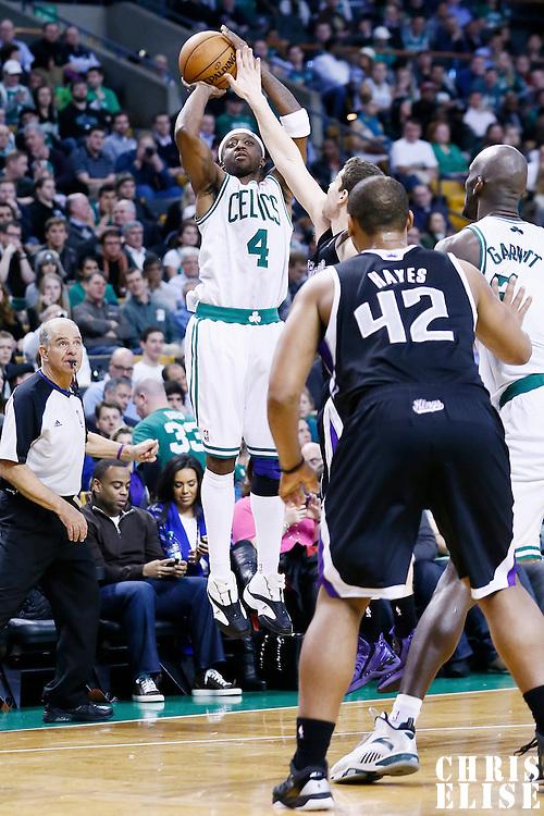30 January 2013: Boston Celtics shooting guard Jason Terry (4) takes a jumpshot over Sacramento Kings point guard Jimmer Fredette (7) during the Boston Celtics 99-81 victory over the Sacramento Kings at the TD Garden, Boston, Massachusetts, USA.