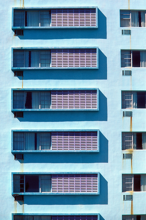Boxed windows form geometric patterns on the Miami Modern (MiMo) style Cadillac Hotel in Miami Beach.  Photographed in 1999.