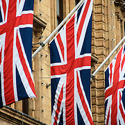 Three Union Jacks adorn the outside of Harrods department store in the Knightsbridge neighborhood of London.