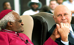 December 16, 2005 - Reconciliation Day..Friday 16th Decemeber 2005..Nobel Square, V & A Waterfront,.Cape Town, South Africa...NOBEL SQUARE UNVEILING!..Two Nobel Peace Prize Laureates Share Their Peace!..Archbishop Emeritus Desmond Tutu & former State President Mr. FW de Klerk join hands during the Nobel Square unveiling ceremony...South Africa's four Nobel Peace Prize Laureates are honoured for their extraordinary achievements of peace & democracy in South Africa with the official unveiling of a sculptural square in the historical heart of Cape Town...Nobel Square is the new home of sculptures of the late Nkosi Albert Luthuli, Archbishop Emeritus Desmond Tutu, former State President FW de Klerk & former President Nelson Mandela as well as a fifth sculpture called 'Peace & Democracy' which is a narrative work acknowledging the contribution of women & children to the attainment of peace in South Africa...PICTURE: MARK WESSELS. (Credit Image: © Mark Wessels/RealTime via ZUMA Wire)