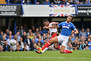 Crawley Town Midfielder, Jason Banton (10) gets a shot at goal challenged by Portsmouth Defender, Christian Burgess (6) during the EFL Sky Bet League 2 match between Portsmouth and Crawley Town at Fratton Park, Portsmouth, England on 3 September 2016. Photo by Adam Rivers.