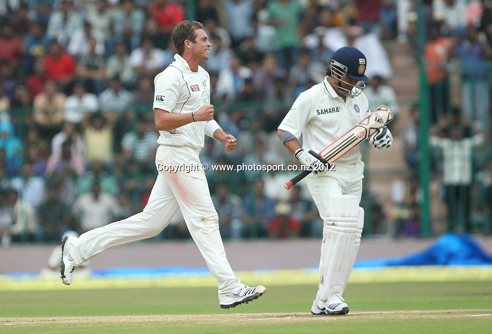 New Zealand cricket tour to India. September 2012 Bengaluru :   NewZealand's Tim Southee celebrate the wicket of India's Sachin Tendulakr   during the 4th day of the test match against NewZealand in Bengaluru on Monday.