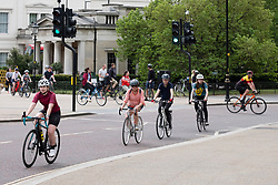 © Licensed to London News Pictures. 16/05/2020. London, UK. Cyclists ride in Hyde Park after the government relaxed the law on the Covid-19 lockdown. It allows people to spend more time outdoors whilst following social distancing. Photo credit: London News Pictures