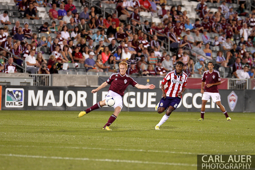 August 18th, 2012: Colorado Rapids midfielder Jeff Larentowicz (4) tries to get the ball away from Chivas USA in the second half at Dick's Sporting Goods Park