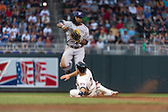 Rickie Weeks #23 of the Milwaukee Brewers makes a leaping throw over Joe Mauer #7 of the Minnesota Twins on May 29, 2013 at Target Field in Minneapolis, Minnesota.  The Twins defeated the Brewers 4 to 1.  Photo: Ben Krause
