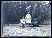two girls with baby doll and dog France ca 1920s