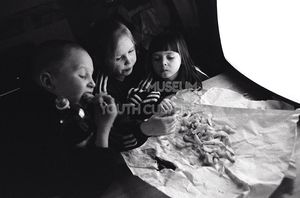 Kids eating fish and chips in front of the TV Newport South Wales