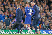 Chelsea midfielder Mason Mount (19) goes off the pitch, injured, during the Champions League match between Chelsea and Valencia CF at Stamford Bridge, London, England on 17 September 2019.